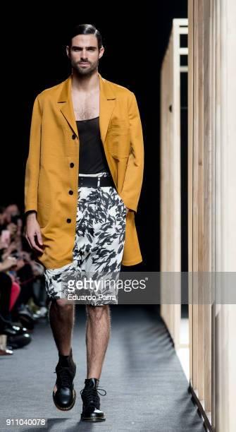 Model Juan Betancourt walks the runway at the Oliva show during the MercedesBenz Fashion Week Madrid Spring7Summer 201819 at Ifema on January 27 2018...