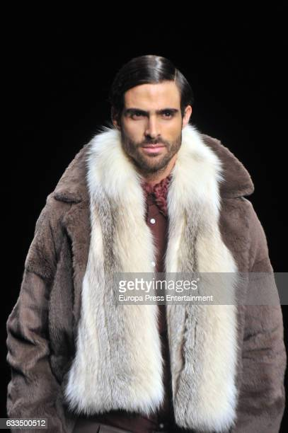 Model Juan Betancourt walks the runway at the VM La Siberia show during the Barcelona 080 Fashion Week Autumn/Winter 2017 on February 1 2017 in...
