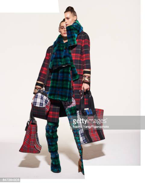 Model Juju Ivanyuk poses at a fashion shoot for Madame Figaro on July 6 2017 in Paris France Coat leggings scarf and boots totes sunglasses PUBLISHED...