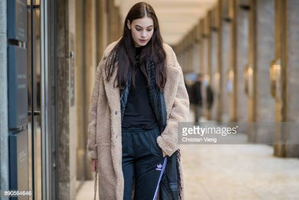 Model Julia Leineweber wearing a HM teddy coat Mango bag Adidas jogger pants Zara sweater HM boots Gucci scarf on December 11 2017 in Duesseldorf...
