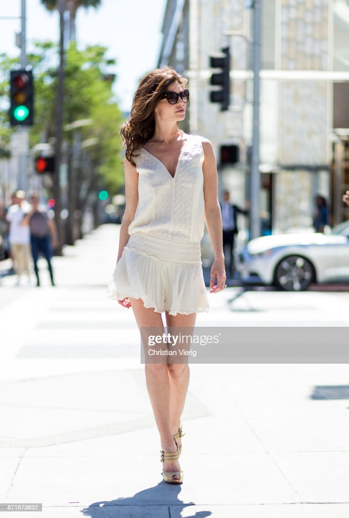 Model Julia Lescova wearing a Magali Pascal dress, Christian Louboutin shoes on April 21, 2017 in Los Angeles, California.