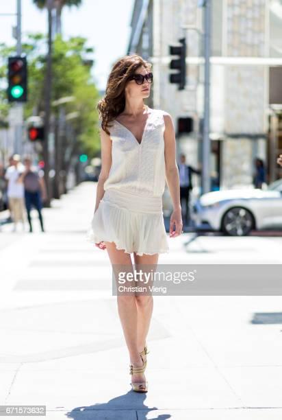 Model Julia Lescova wearing a Magali Pascal dress Christian Louboutin shoes on April 21 2017 in Los Angeles California