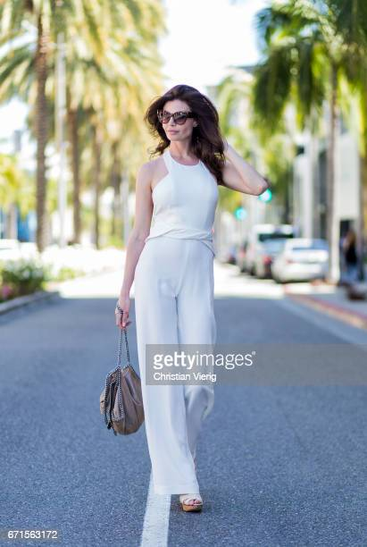 Model Julia Lescova wearing a white jumpsuit Ramy Brook New York Chloe shoes Stella McCartney bag Celine sunglasses on April 21 2017 in Los Angeles...