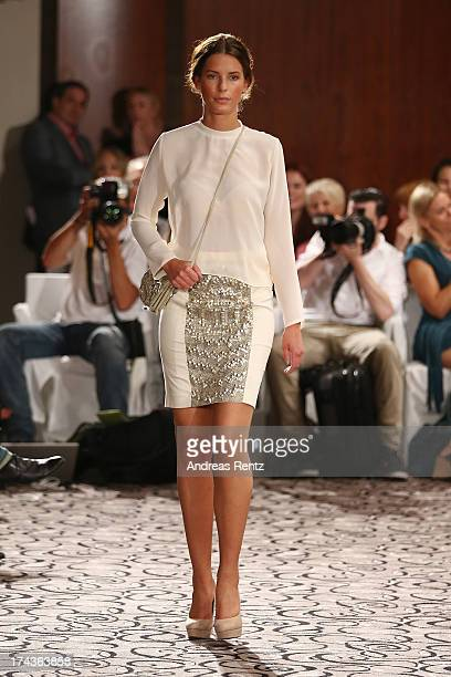 Model Julia Trainer walks the runway during the Marcel Ostertag fashion show at Charles Hotel on July 24 2013 in Munich Germany