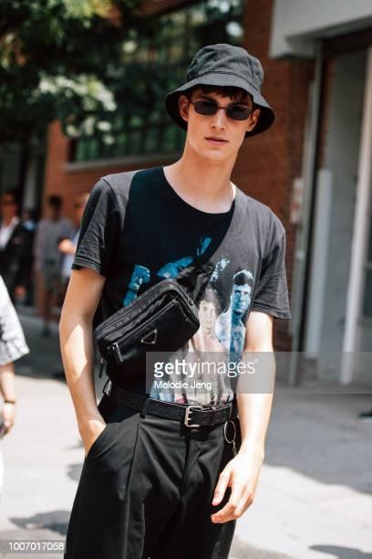 6f14669de39 Model Julian Weigl wears a black bucket hat and black Prada crossbody belt  bag during New