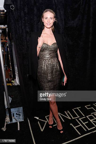 Model Julie Henderson poses backstage at the Mark And Estel runway show during MercedesBenz Fashion Week Spring 2014 at The Studio at Lincoln Center...