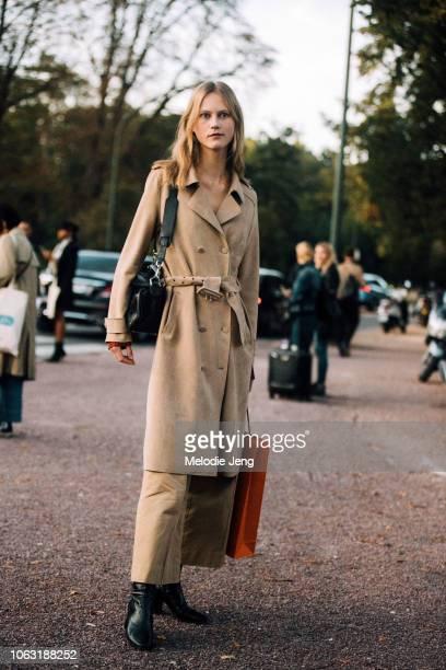 Model Julie Hoomans wears a light brown belted suede coat after the Hermes show during Paris Fashion Week Spring/Summer 2019 on September 29 2018 in...