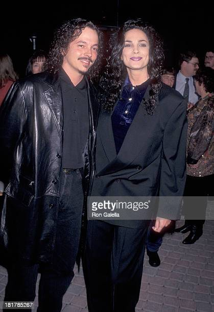 Model Julie Strain and husband Kevin Eastman attend 'The Beautician and the Beast' Hollywood Premiere on February 3 1997 at Paramount Theatre...