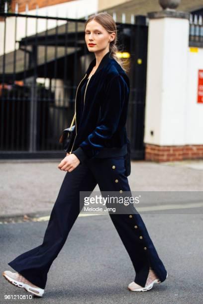 Model Julita Formella wears a blue velvet jacket and blue pants side buttons during London Fashion Week Spring/Summer 2018 on September 17 2017 in...