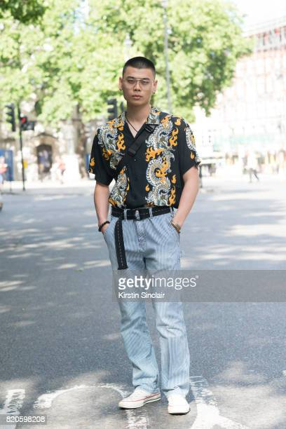 Model Justin wears a vintage Guess shirt, Dickies trousers, vintage belt and glasses and Converse trainers on day 3 of London Collections: Men on...