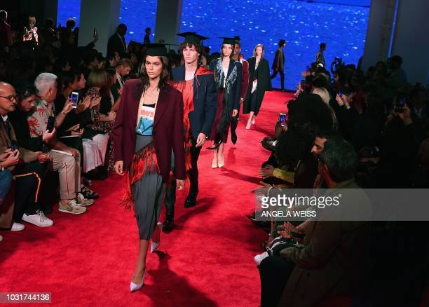US model Kaia Gerber and other models walk the runway at the Calvin Klein 205W39NYC Spring 2019 Men's and Women's runway show during New York Fashion...