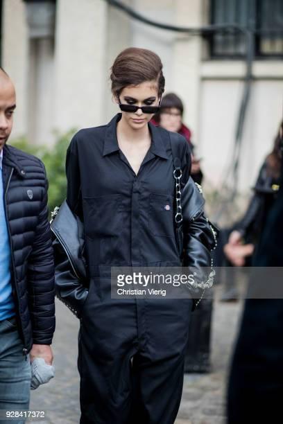 Model Kaia Gerber is seen wearing Dickies overall outside Miu Miu during Paris Fashion Week Womenswear Fall/Winter 2018/2019 on March 6 2018 in Paris...