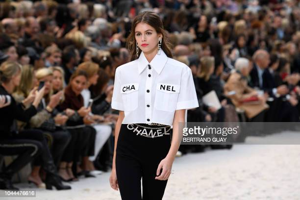 US model Kaia Gerber presents a creation by Chanel during the SpringSummer 2019 ReadytoWear collection fashion show at the Grand Palais in Paris on...