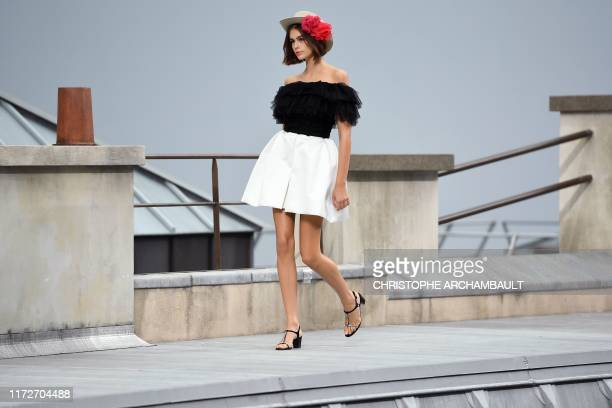 Model Kaia Gerber presents a creation by Chanel during the Women's Spring-Summer 2020 Ready-to-Wear collection fashion show at the Grand Palais in...