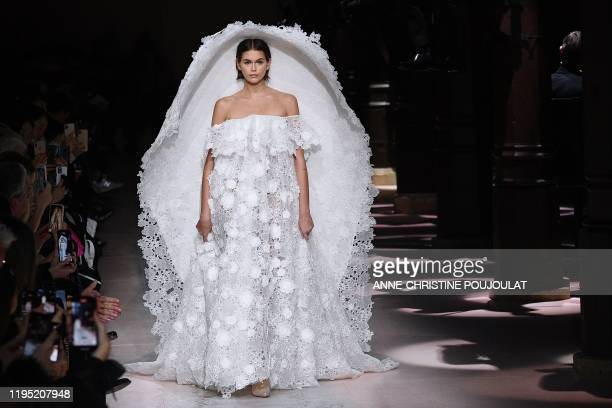Model Kaia Gerber presents a creation by Givenchy during the Women's Spring-Summer 2020 Haute Couture collection fashion show in Paris, on January...