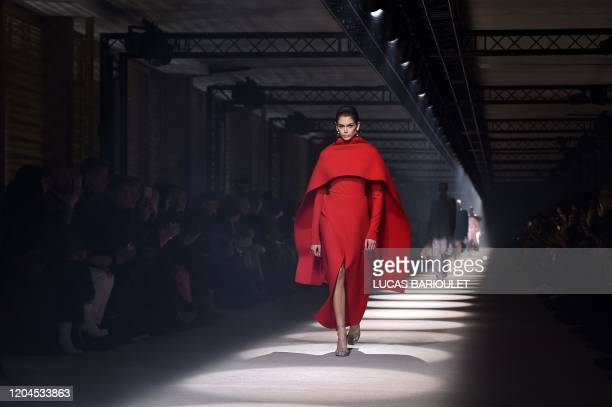 Model Kaia Gerber presents a creation by Givenchy during the Women's Fall-Winter 2020-2021 Ready-to-Wear collection fashion show at the...