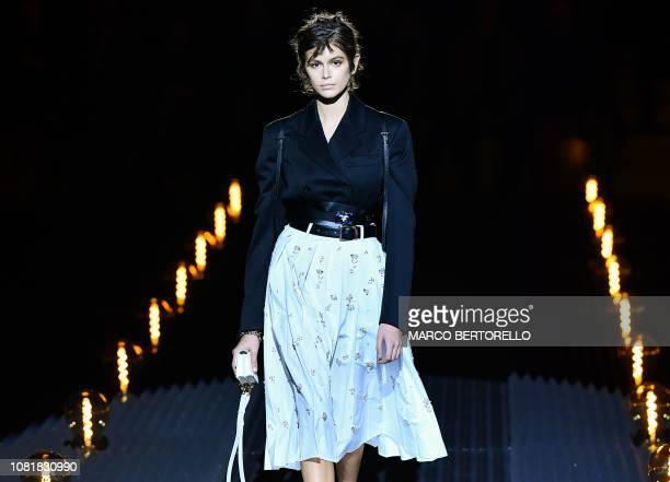 Model Kaia Gerber presents a creation for fashion house Prada during the Men's Fall/Winter 2019/20 fashion shows in Milan, on January 13, 2019.