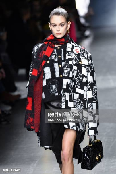 Model Kaia Gerber presents a creation for fashion house Versace during its Men's/Women's Fall/Winter 2019/20 fashion show in Milan, on January 12,...