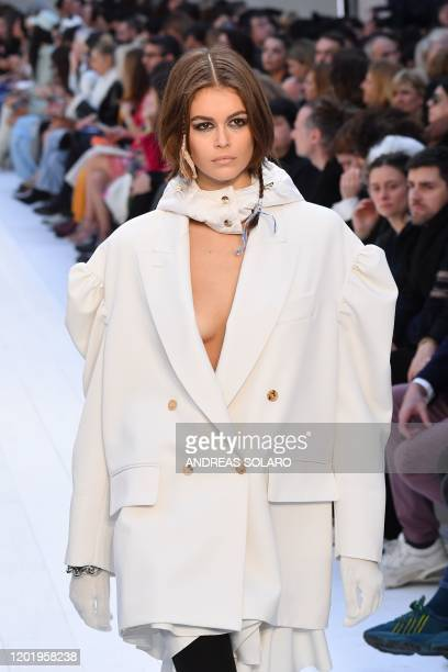 Model Kaia Gerber presents a creation for Max Mara's Women Fall - Winter 2020 fashion collection on February 20, 2020 in Milan.