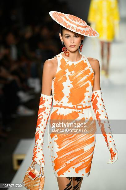Model Kaia Gerber presents a creation for Moschino fashion house during the Women's Spring/Summer 2019 fashion shows in Milan on September 20 2018