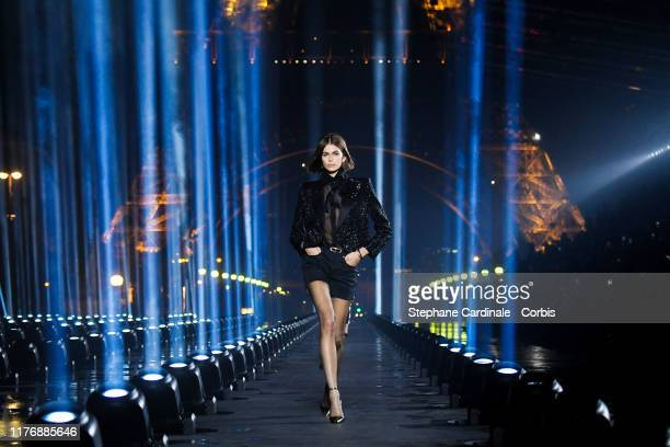 Model Kaia Gerber walks the runway during the Saint Laurent Womenswear Spring/Summer 2020 show as part of Paris Fashion Week on September 24, 2019 in...