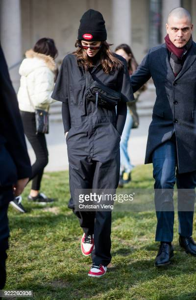 Model Kaia Gerber wearing Supreme beanie overall fanny bag seen outside Alberta Ferretti during Milan Fashion Week Fall/Winter 2018/19 on February 21...