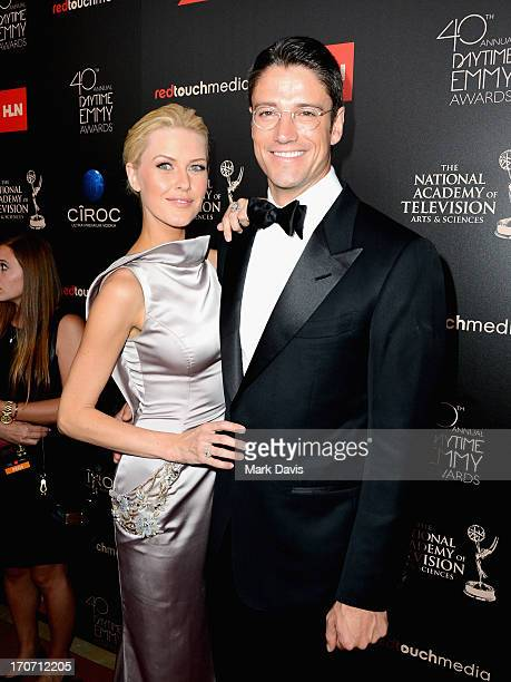Model Kaitlin Robinson and actor James Scott attend The 40th Annual Daytime Emmy Awards at The Beverly Hilton Hotel on June 16 2013 in Beverly Hills...