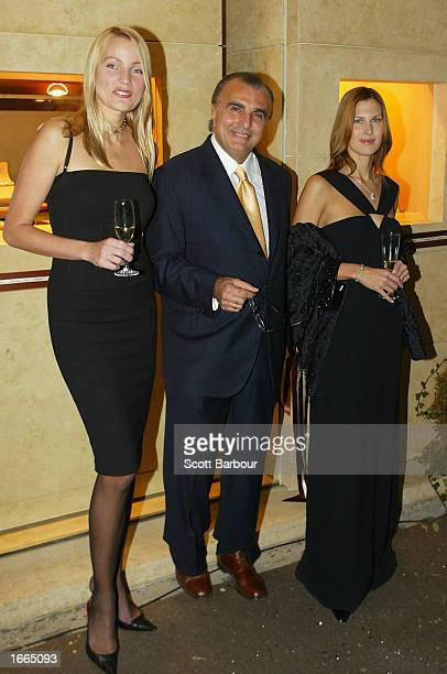 Model Kaja Wunder store owner Edmond Avakian and actress Julienne Davis pose for photographers as they arrive at the Avakian store launch party...