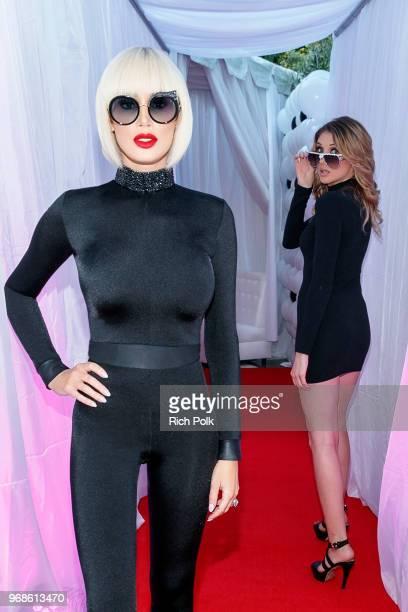 Model Kaki Swid and Ashleigh Ethridge attend an event where model Kaki Swid hosts a designer event on June 4 2018 in Beverly Hills California