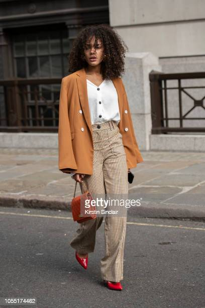 Model Kalixte wears a Bershka Blazer shirt and trousers Marc Jacobs bag and Guess shoes during London Fashion Week September 2018 on September 15...