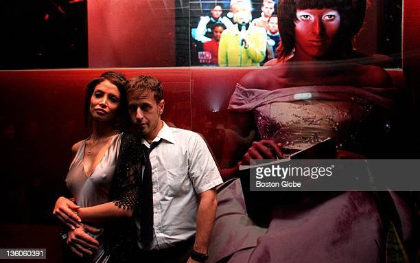Model Kara Young and photographer Steven Klein stand next to one of Klein's pictures at Avalon in Boston Mass while they hosted a party at Avalon to...