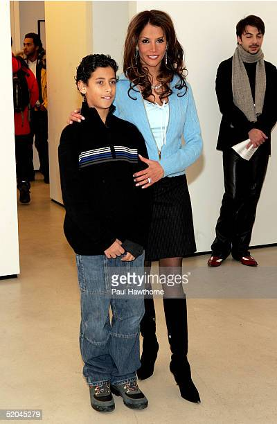 """Model Kara Young and son Nick D'Orazio attend the opening reception for """"Pam: American Icon"""" by photographer Sante D'Orazio at the Stellan Holm..."""