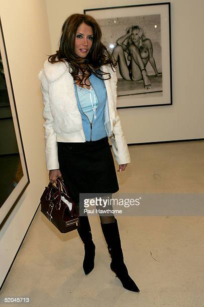 Model Kara Young attends the opening reception for Pam American Icon by photographer Sante D'Orazio at the Stellan Holm Gallery January 21 2005 in...