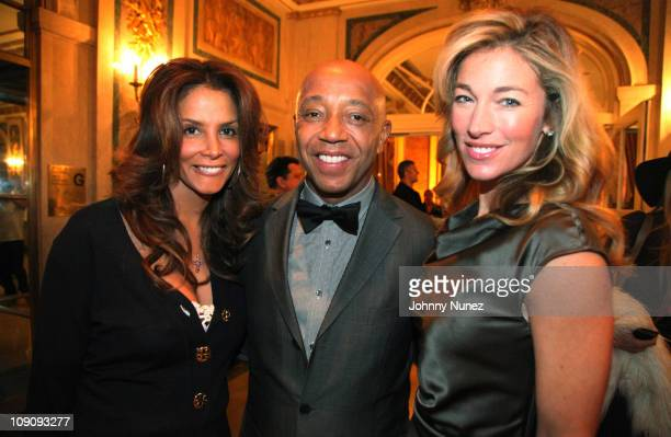 Model Kara Young entrepreneur and philanthropist Russell Simmons and model Elaine Irwin attend the Rush HeARTS Education luncheon benefit at The...