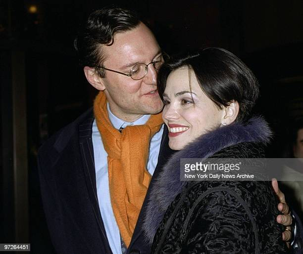 Model Karen Duffy seems to like what husband John Lambros is whispering in her ear arrival at screening of the movie O Brother Where Art Thou at the...