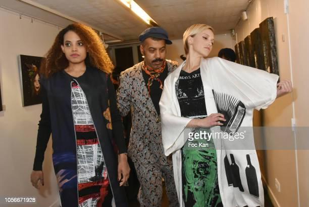 Model, Karim Bonnet fashion designer of Impasse De la Defense and Agata Suduiko attend the Impasse De La Defense Show At Galerie 59 Rue de Rivoli on...