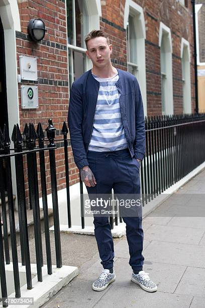 Model Karl Knight wears a Preview London suit Zara skirt and Saint Laurent trainers on day 1 of London Collections Men on June 12 2015 in London...