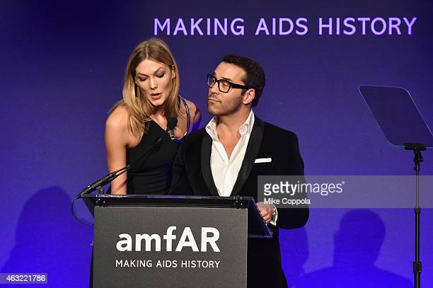 Model Karlie Kloss and actor Jeremy Piven speak onstage at the 2015 amfAR New York Gala at Cipriani Wall Street on February 11, 2015 in New York City.