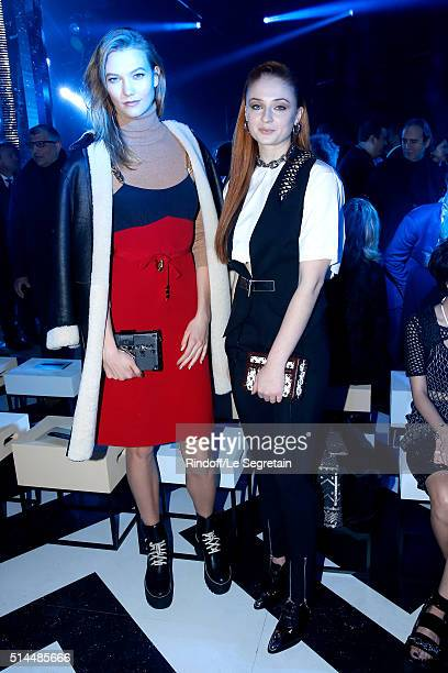 Model Karlie Kloss and Actress Sophie Turner attend the Louis Vuitton show as part of the Paris Fashion Week Womenswear Fall/Winter 2016/2017 Held at...