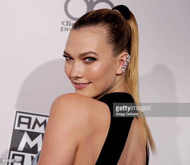 Model Karlie Kloss arrives at the 2016 American Music Awards at Microsoft Theater on November 20 2016 in Los Angeles California