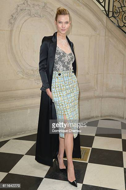 Model Karlie Kloss attends the Christian Dior show as part of the Paris Fashion Week Womenswear Spring/Summer 2017 on September 30 2016 in Paris...