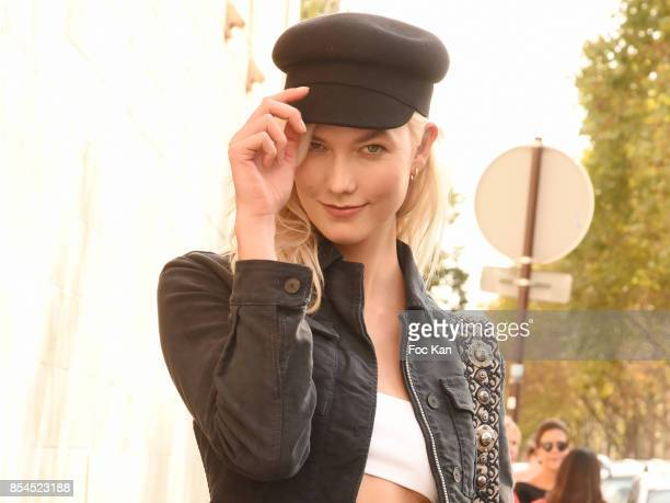 Model Karlie Kloss attends the Christian Dior show as part of the Paris Fashion Week Womenswear Spring/Summer 2018 on September 26 2017 in Paris...