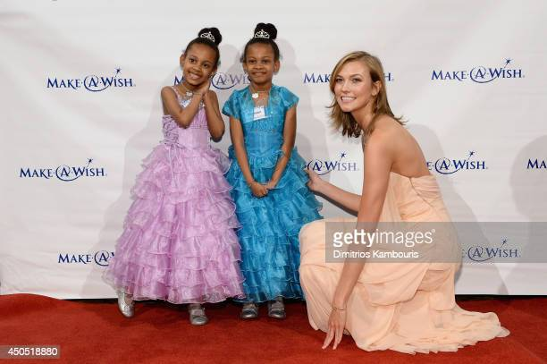 Model Karlie Kloss poses with Wish Kids Shannon and Madison at the Make-A-Wish Metro New York Annual Gala - An Evening of Wishes at Cipriani, Wall...