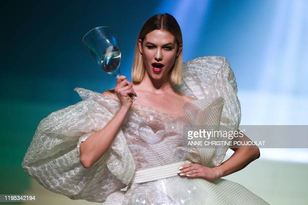 TOPSHOT US model Karlie Kloss presents a creation by Jean Paul Gaultier during the Women's SpringSummer 2020 Haute Couture collection fashion show in...