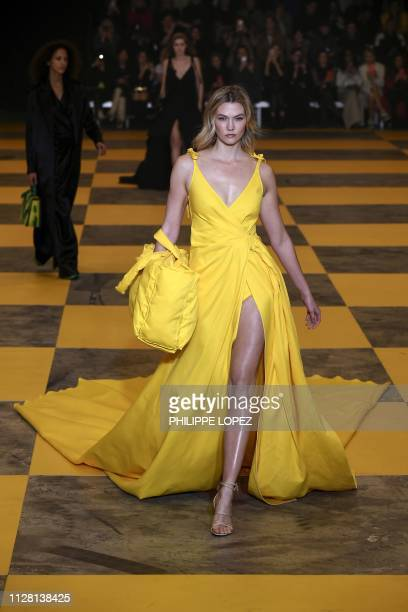US model Karlie Kloss presents a creation by OffWhite during the Women's FallWinter 2019/2020 ReadytoWear collection fashion show in Paris on...