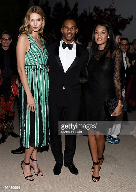 Model Karlie Kloss Professional Football Player Victor Cruz and Elaina Watley attend the 12th annual CFDA/Vogue Fashion Fund Awards at Spring Studios...