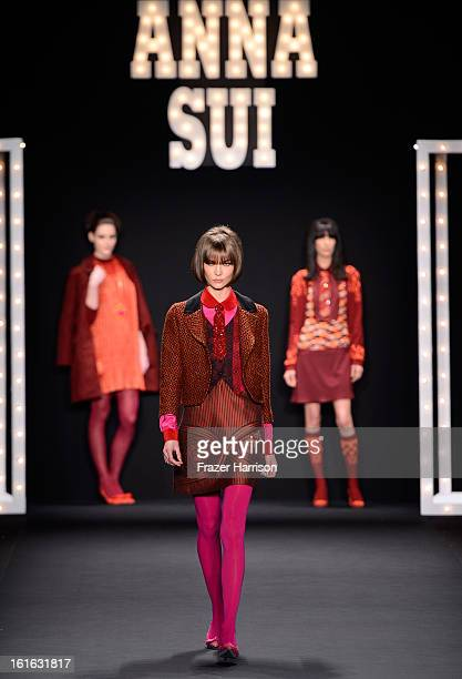 Model Karlie Kloss walks the runway at the Anna Sui Fall 2013 fashion show during Mercedes-Benz Fashion Week at The Theatre at Lincoln Center on...