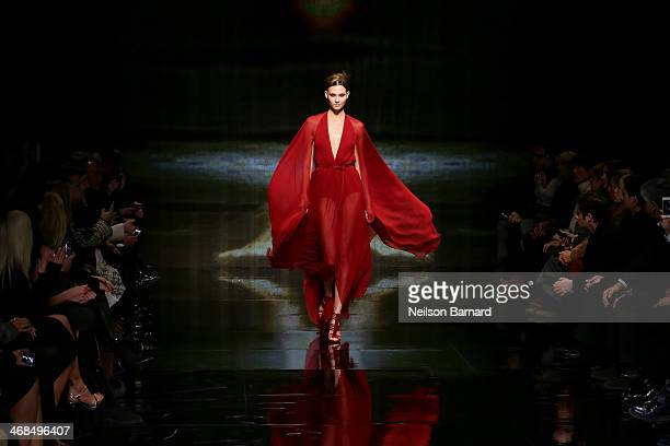 Model Karlie Kloss walks the runway at the Donna Karan New York 30th Anniversary fashion show during MercedesBenz Fashion Week Fall 2014 on February...