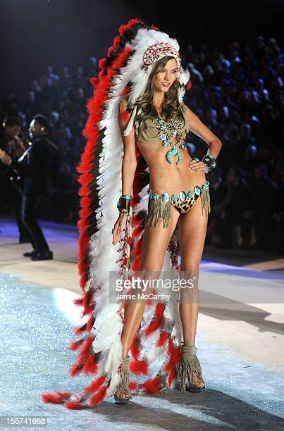Model Karlie Kloss walks the runway during the 2012 Victoria's Secret Fashion Show at the Lexington Avenue Armory on November 7 2012 in New York City