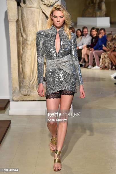 Model Karlie Kloss walks the runway during the Dundas Haute Couture Fall Winter 2018/2019 show as part of Paris Fashion Week on July 2 2018 in Paris...